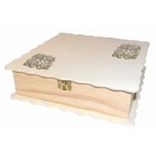 Rosetón de metal filigrana color bronce en una caja